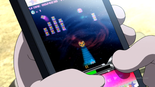 Space Dandy sure does enjoy referencing its Galaga. Every 7th episode in both seasons has has some form of Galaga reference. In fact, the Galaga version Meow is playing here is a Japan-only mobile version of Galaga called Space Galaga.
